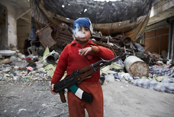 8yearold-rebel-fighter-syria-by-sabastianotomada.com_1